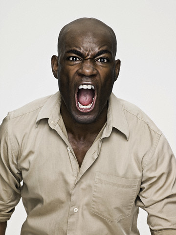 African american man shouting --- Image by © Image Source/Corbis